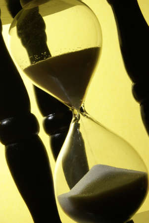 The sands of time trickle through this hourglass. Stock Photo