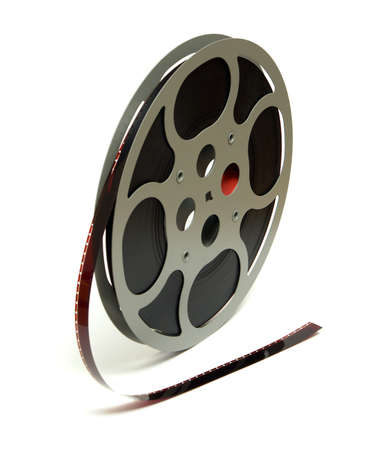 16mm: An isolated shot of a 16mm movie reel for projection playing at theaters.