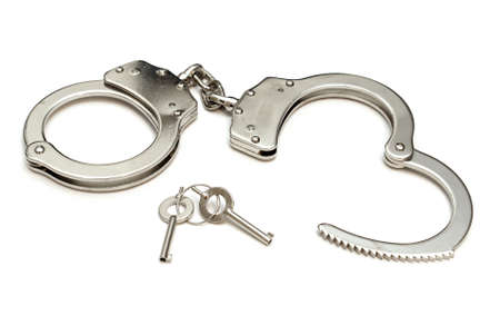 An isolated shot of a pair of police quality handcuffs.