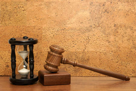 An hourglass and gavel represent a concept based on needing time for legal aid. Stock Photo - 11787978