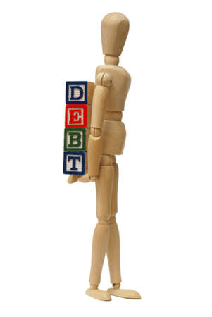 owe: A mannequin carries his debts around with himself. Stock Photo