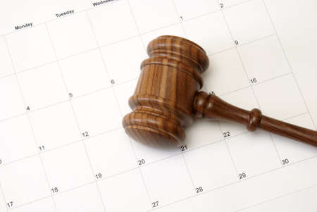 A gavel and calendar represent a court or an auction reminder. Stock Photo