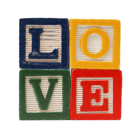 Alphabet blocks are used to create the word love in the shape of a square.