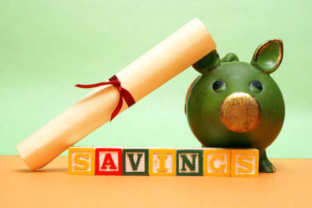savings goals: A concept related to saving early in a childs life for their future education. Stock Photo