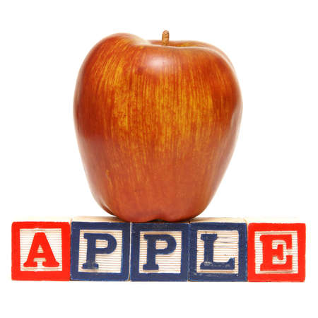 Alphabet blocks spell out the word apple with the healthy fruit being displayed. Stock Photo - 11957967