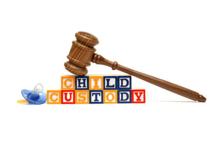 A group of isolated objects in regards to the concept of child custody. photo
