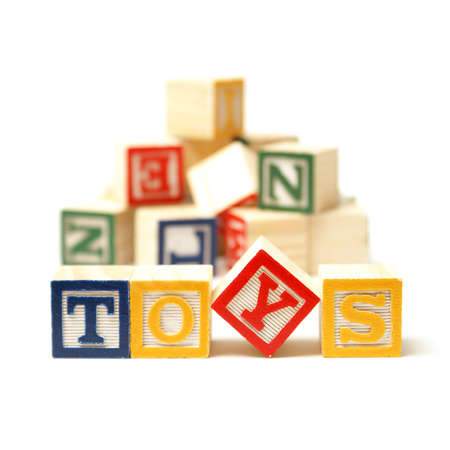 Alphabet blocks spell out the word toys with a touch of creativity. Stock Photo - 12365285