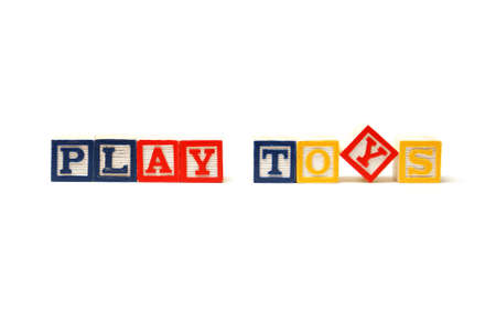 Alphabet blocks spell out play toys with a childish touch of creativity. Stock Photo - 12365273
