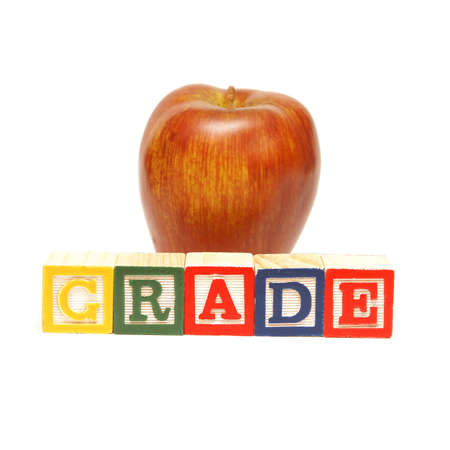 The spelling of the word grade using alphabet blocks. Stock Photo - 12365357