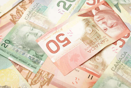 canadian cash: A closeup shot of Canadian currency in twenties and fifties.