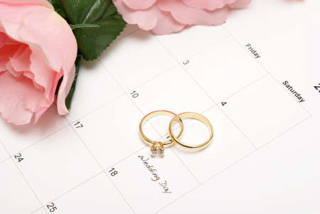 rose ring: A note on a calendar sets a reminder for the wedding day.