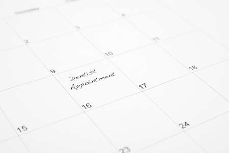appointment book: A reminder is wrote on a calendar to go to the dentist appointment. Stock Photo