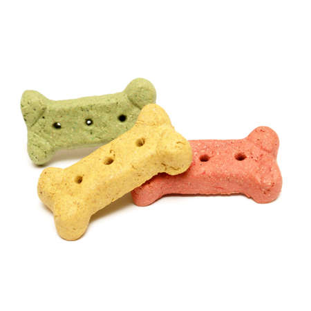 flavoured: Three various flavoured dog treats isolated over white.
