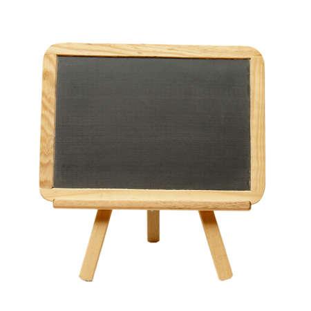Een geïsoleerde shot van een leeg bord op een schildersezel.
