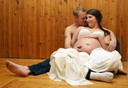 A couple of young love birds expecting their first child. photo