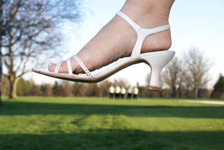 heels shoes: A newly wed bride crushes the groomsman off in the distance.