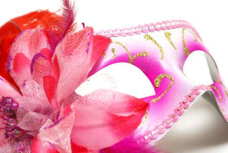 お祭りでのあなたのアイデンティティを隠すための白い背景の上のフェミニンなベネチアン マスク。