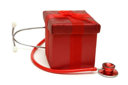 A red gift box and stethoscope isolated on white. photo