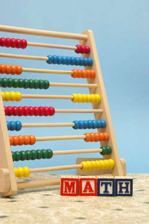 A childs abacus and alphabet blocks to represent the subject of learning math. photo