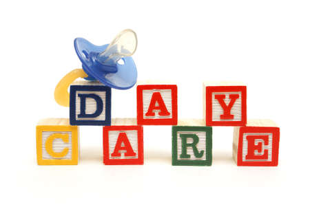 daycare: An infants pacifier next to the words day care.