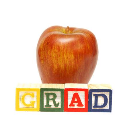 The spelling of the word grad using alphabet blocks. Stock Photo - 13735462
