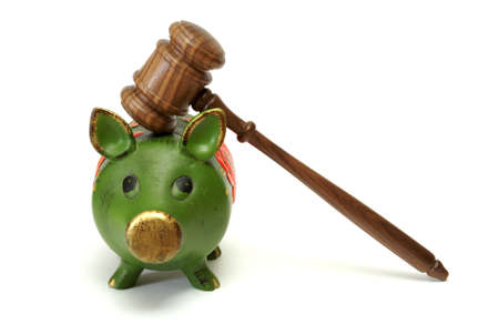 A pig bank and a mallet represent legal expense concepts. Stock Photo - 13735465