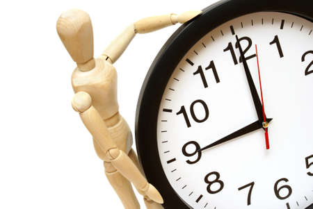 A mannequin and clock are on white to represent time management. Stock Photo - 13735468