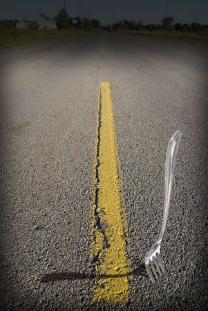 fork in the road: A literal meaning of the saying a fork in the road. Stock Photo