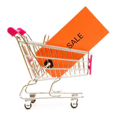 ペニー セーバー考え方のためのショッピング カートと販売タグの分離ショット。 写真素材