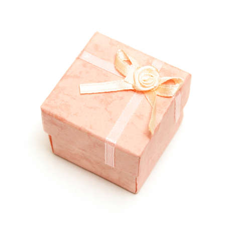 An isolated shot of a pink ring box to surprise the special lady with some jewelry. photo