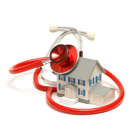 realestate: A model house is being doctored by a stethoscope.