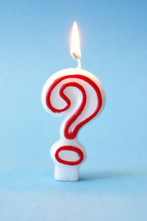 A festive candle to celebrate someones questionable age. Stock Photo