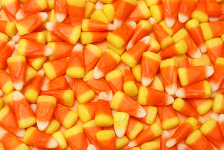 A closeup of many pieces of candy corn.