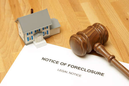 unlucky: A notice of foreclosure to this unlucky home owner. Stock Photo