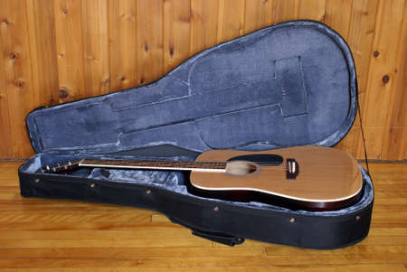 An acoustic guitar in a nice felt lined case. Stock Photo - 16401260