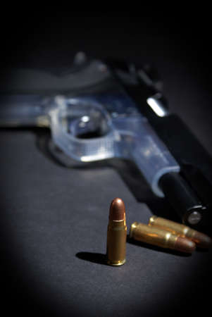 A handgun and selective focus on the upright bullet. Stock Photo - 16401252