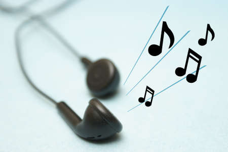 A set of headphones play some musical notes for the listener.