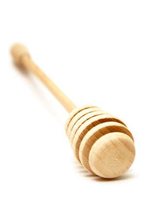 A shallow DOF shot of a handmade wooden honey stick. Reklamní fotografie