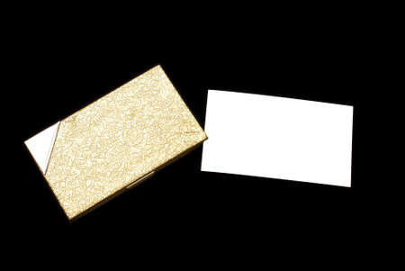 A stylish gold plated business card holder and blank card for your copy. photo