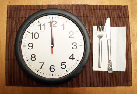 This clock reminds us to eat a healthy lunch at the proper time. Stock Photo - 17598230