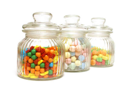 A variety of tasty candies in cliche candy jars. photo