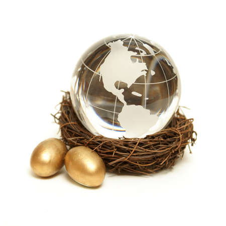 retirement nest egg: The world rests in the nurture of a wealthy nest for global finance concepts.