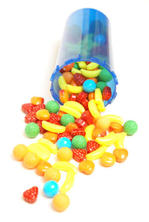 A conceptual image of candy spilling from a pill bottle to be mothers little helper. photo