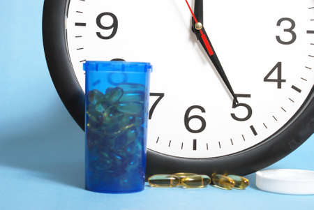 dose: Its time to take the daily dose. Stock Photo