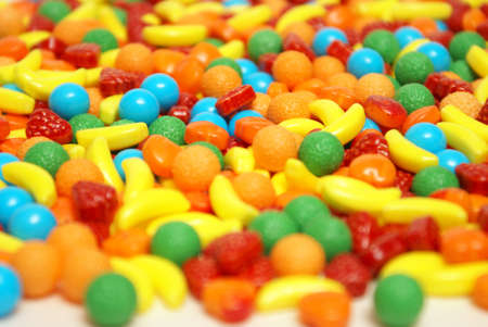 fruit candy: A variety of fruit flavored candies at a macro shot level.