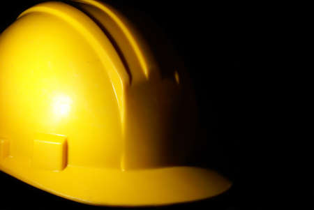 A low key shot of a construction workers hardhat for extra security on the job site.