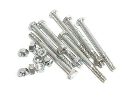 metal fastener: A pile of nuts and a bolts isolated on white.