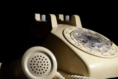 A low key shot of a rotary phone on hold. Stock Photo - 18731962