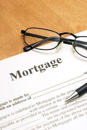 A closeup shot of mortgage papers and glasses to read the fine print. Stock Photo - 18942851