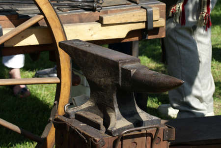 forger: A closeup shot of a blacksmiths anvil outside. Stock Photo